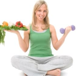 woman with veggies and small dumbbell