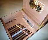 open humidor with cigar