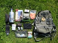 backpack and stuff on grass