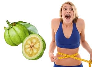 garcinia-cambogia and woman measuring waist