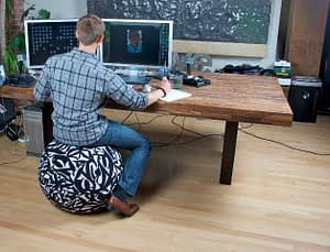 Man at computer desk on yoga ball