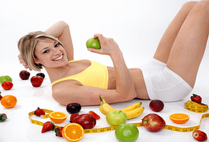 woman lying on floor and fruits around her