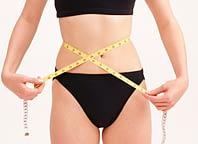 Woman checking waist