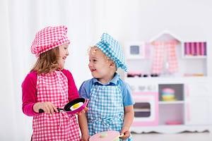 kids in toy kitchen